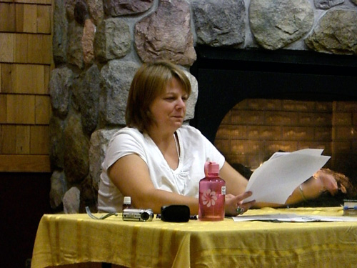 Kim at Poetry Potluck, photo by Beth Millner