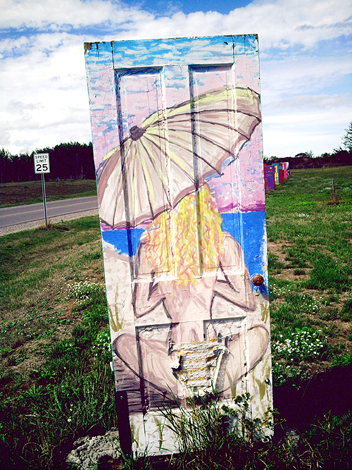 Marquette Michigan Doors, She's Come Undone, photo by Kim Nixon, door artist unknown